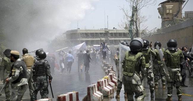 The Latest: Afghan chief executive goes on TV after bombing