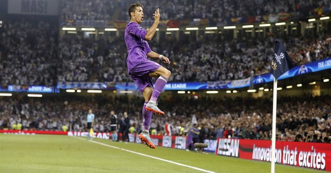 The Latest: Real Madrid lifts Champions League trophy again