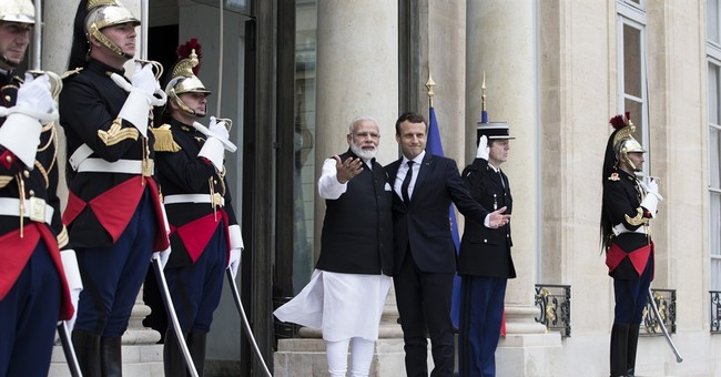 India, France show common front on climate change fight