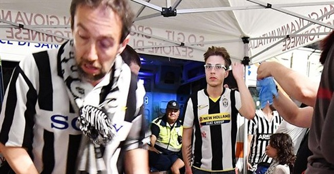 Fans in near-stampede in Turin after Champions League match