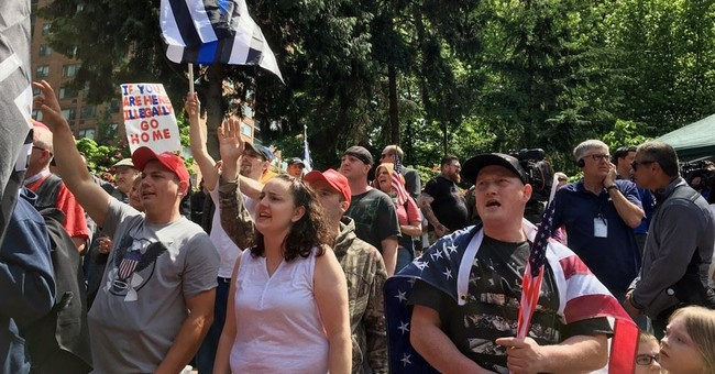 Portland police arrest 14 during rival protests, clashes