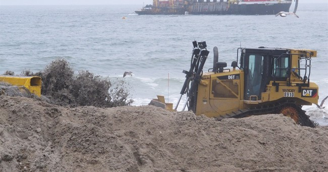 Help arrives for Sandy-wrecked town as others resist dunes