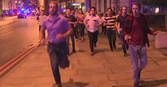 UK hails man who fled attack holding beer an unlikely hero