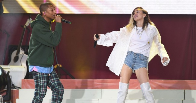The Latest: Grande, Katy, Liam Gallagher sing for Manchester