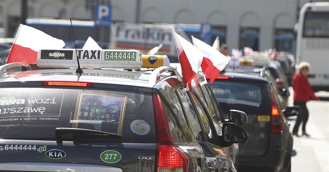 Polish taxi drivers protest growth of unlicensed drivers