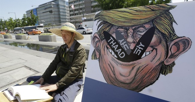 South Koreans Protest Unauthorised Transport Of THAAD Launchers