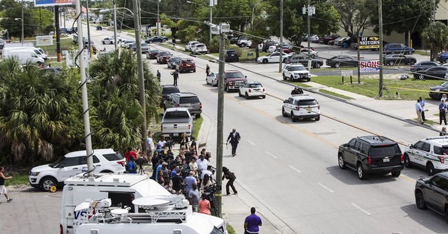 The Latest: Company  'hearbroken' over workplace shooting