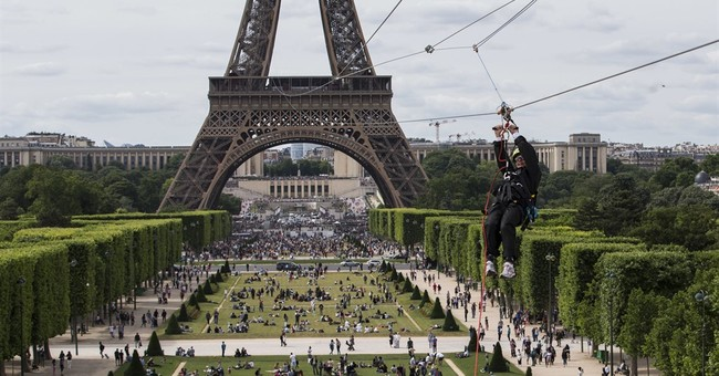 What a rush: AP reporter zip lines off the Eiffel Tower
