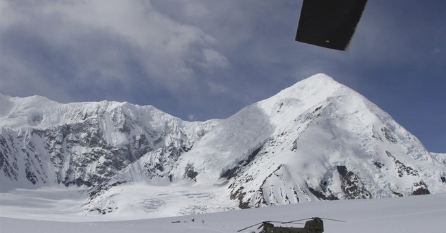 Rescuers chip fallen climber from ice on Alaska mountain