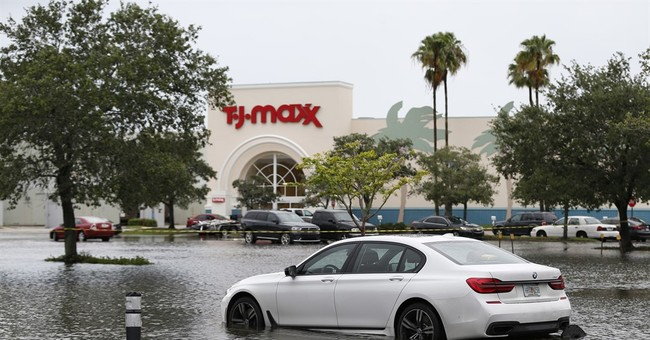 The Latest: Huge outlet mall closed due to Florida flooding