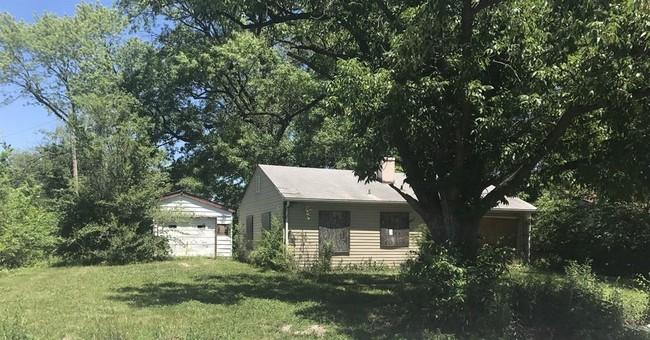 Coroner: Nevada woman says child's body in Illinois garage