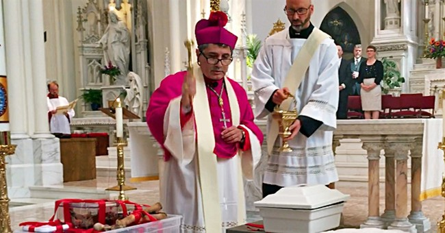 Remains of former slave eyed for sainthood moved to church