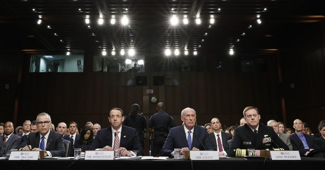 The Latest: Intelligence chiefs unsure what can say publicly