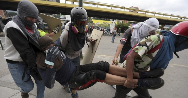 Protester and guardsman killed as Venezuela unrest persists