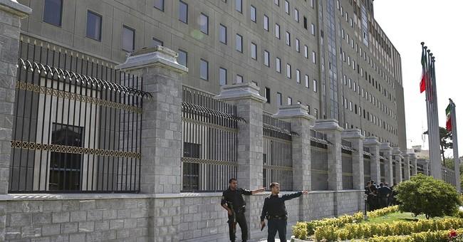 1 dead in twin attacks on Iran parliament, Khomeini shrine