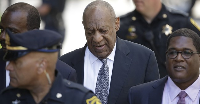 The Latest: Cosby's decade-old testimony is read to the jury