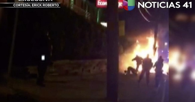Burning bystander seen on video being kicked by police