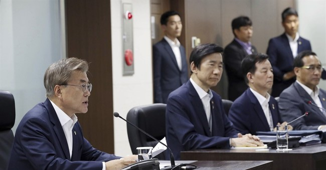 Korea leader warns North after latest missile launch