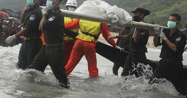 Heavy rains fall as ships, locals search Myanmar crash site