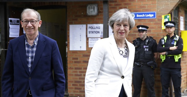 Wounded May soldiers on as election shock complicates Brexit