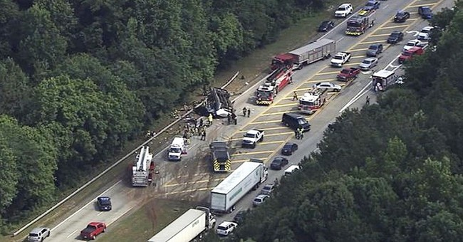 The Latest: 9 still hospitalized after deadly bus crash