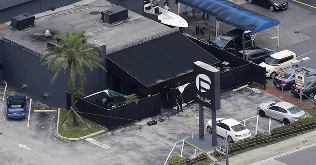 The Latest: Uncle says Orlando shooter's widow is innocent
