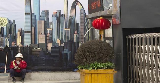IMF raises China growth forecast but warns on debt