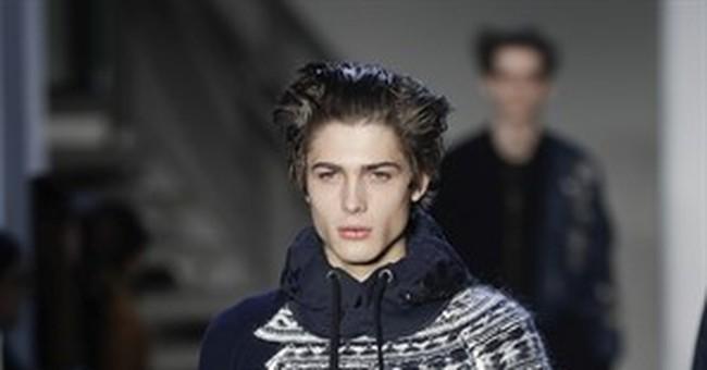 Impish, boyish looks permeate Milan's menswear runways