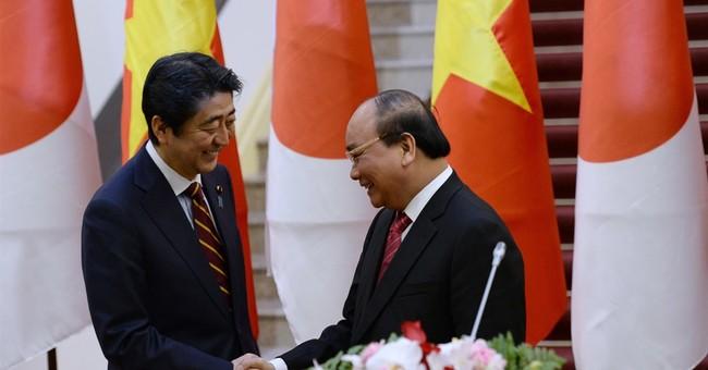In Hanoi, Abe says Japan will provide Vietnam patrol vessels
