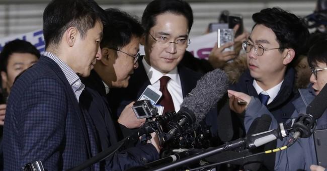 South Korea seeks arrest of Samsung scion in graft scandal