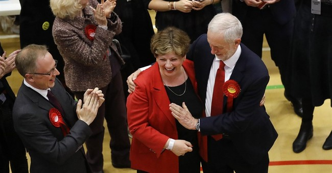 Up high? Too slow! Corbyn's high-five ends in awkward thud