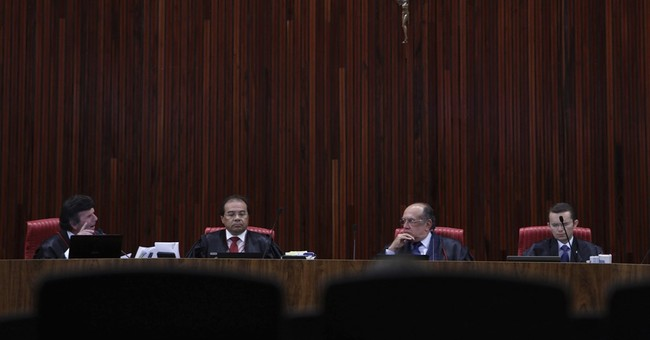 The Latest: Brazil's electoral court keeps Temer in office