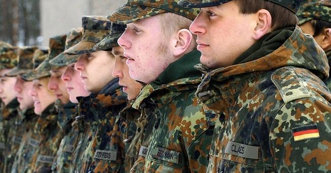 Germany's Merkel seeks to ease tensions with military