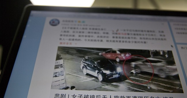China ponders public morality after video of gruesome death