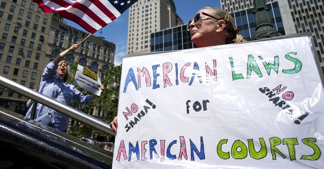 The Latest: Arrests made at anti-Shariah rally in Seattle
