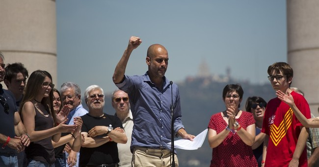 Soccer coach Guardiola leads Catalan independence rally
