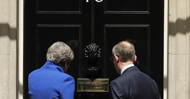 The Latest: UK prime minister insists she is staying put