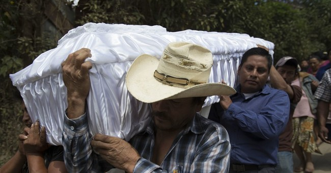Guatemala prosecutors eye president in kids' home fire probe