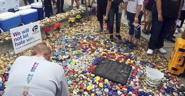 The Latest: Thousands honor Pulse victims at ceremony