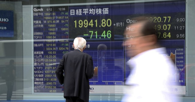 Asian shares mostly lower after technology shares fall in US