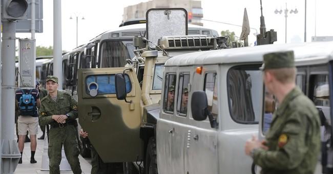 Anti-Kremlin protesters fill Russian streets, Putin critic Navalny jailed