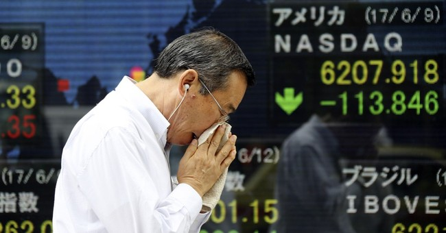 Global markets slide, led by technology shares