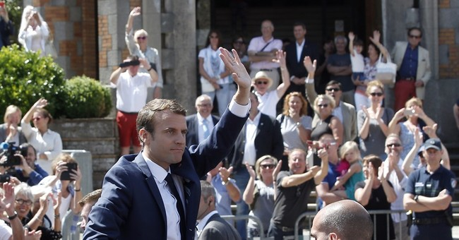 Opposition to Macron sweep may end up in French streets