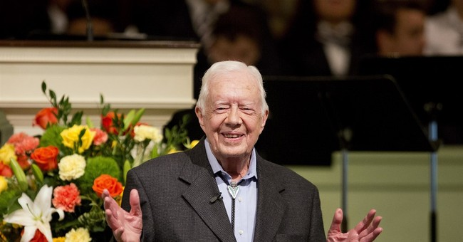 Former President Carter shakes hands with everyone on flight