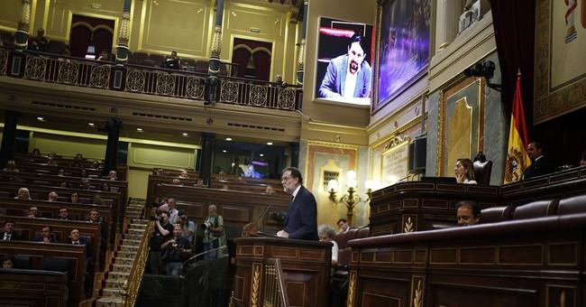 Spain PM Rajoy fends off criticism in no-confidence debate
