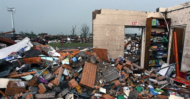Schools settle with families of 7 children killed in tornado