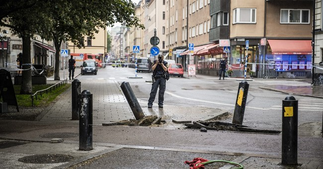 Van rams cab in Stockholm; police say not terror-related