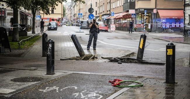 Van rams cab in Stockholm; police say not terror-related