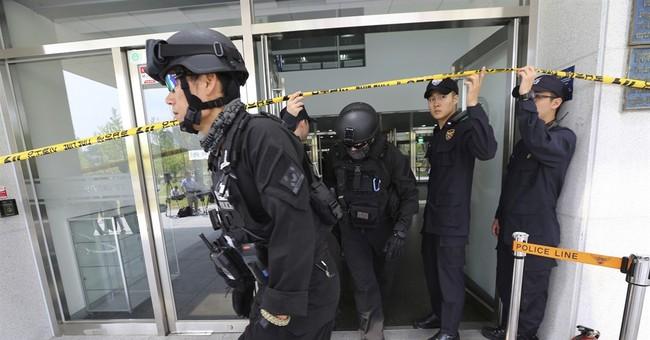 South Korean professor hurt by explosive device in office