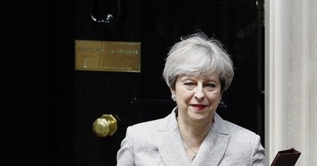 The Latest: UK's May cracks joke about election disaster